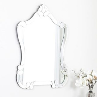 A bevelled silver mirror.