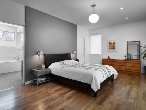 Bedroom with gray accent wall.