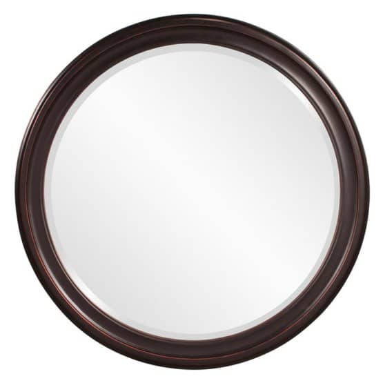A round mirror with hardwood frame.