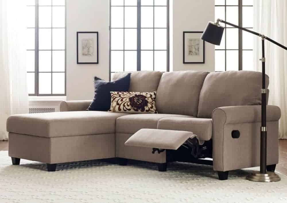 Reclining sectional sofa with storage chaise and woven fabric upholstery.