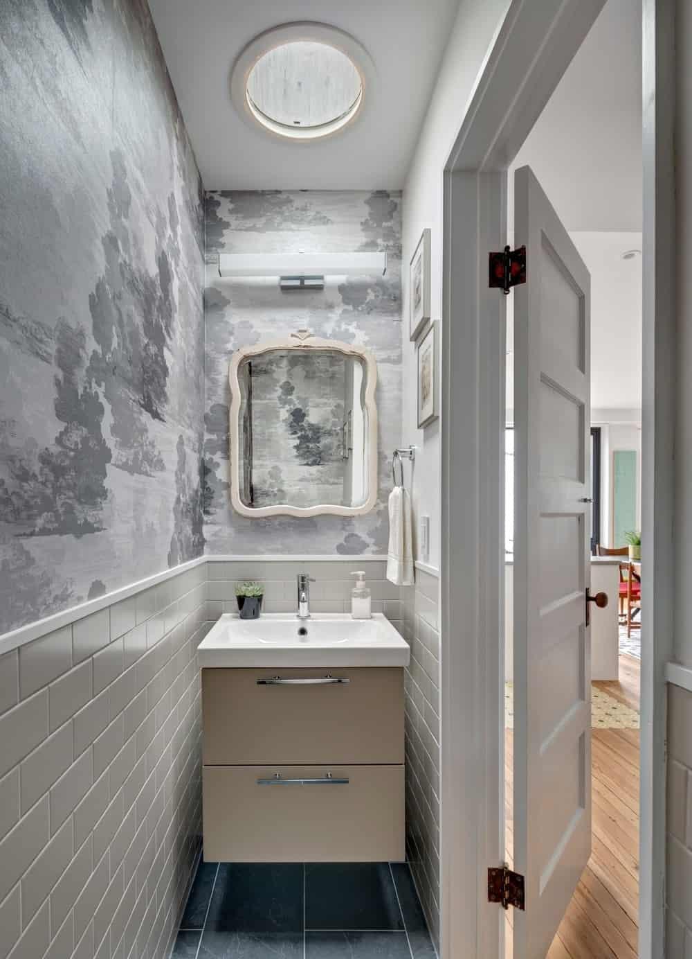 The house also has a washroom with a nice wall and flushmount lighting. Photo Credit: Francis Dzikowski/OTTO