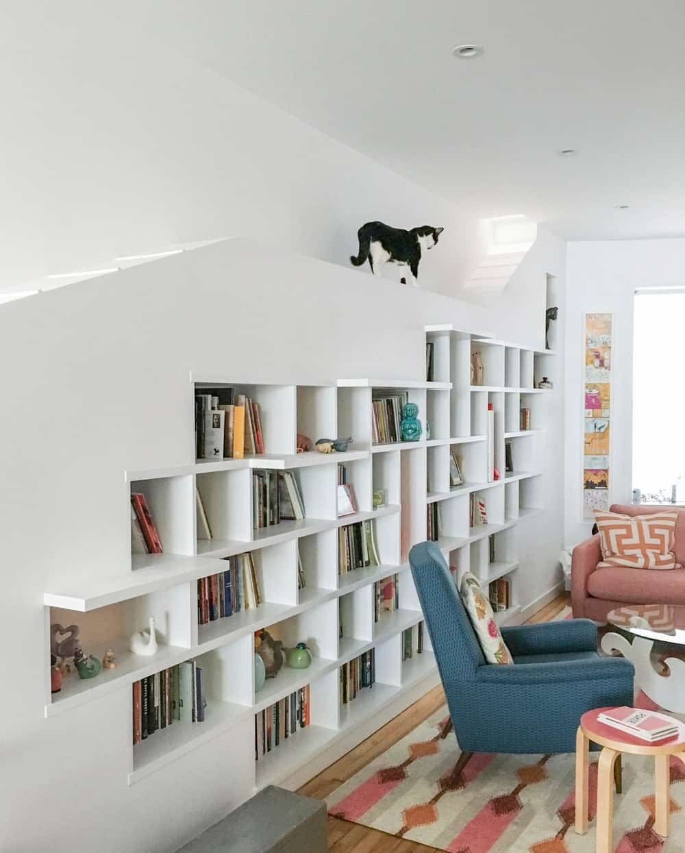 Another look of the living room showcasing the well-made bookshelf and cat area. Photo Credit: Francis Dzikowski/OTTO