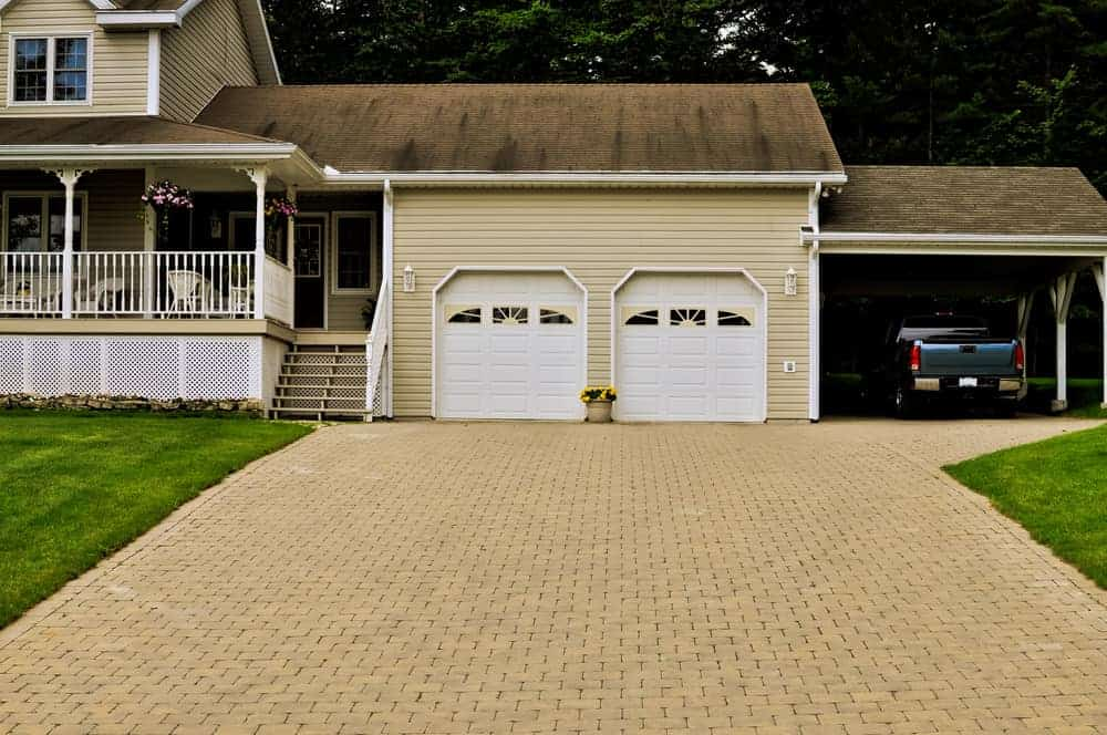 House with a carport attached to two-car garage