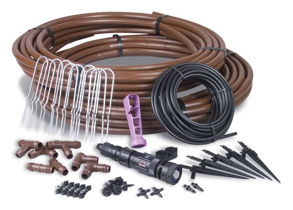 Drip irrigation gardener's drip kit with installation tool.