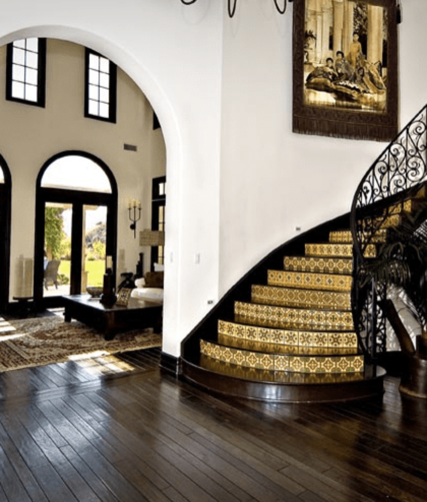 Khloe Kardashian's home foyer boasts Family and friends are welcomed by a grand-looking foyer with a hardwood flooring and a spiral staircase.