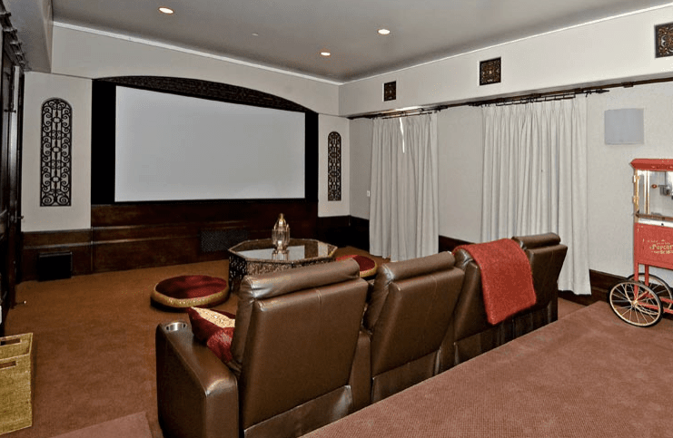 The home theater can adds entertainment to the mansion. The carpet flooring and looks perfect with the theater seating.