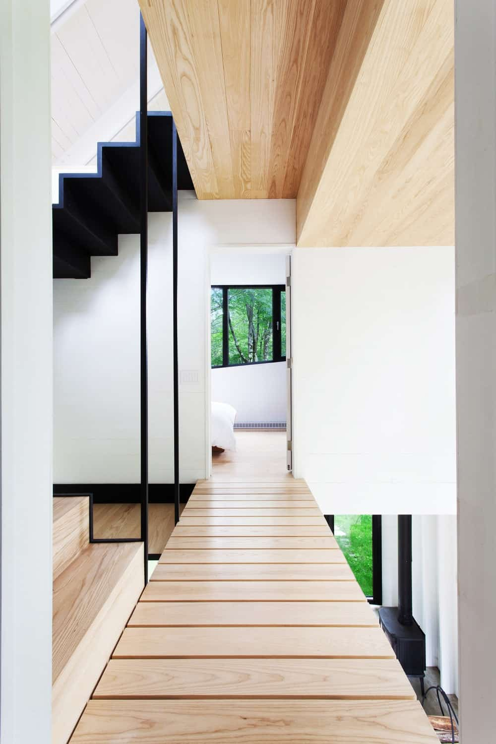 The staircase leading to a steep hallway made of hardwood. Photo Credit: Francis Pelletier