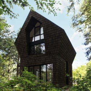 The house stands beautiful in the center of landscape trees. Photo Credit: Francis Pelletier