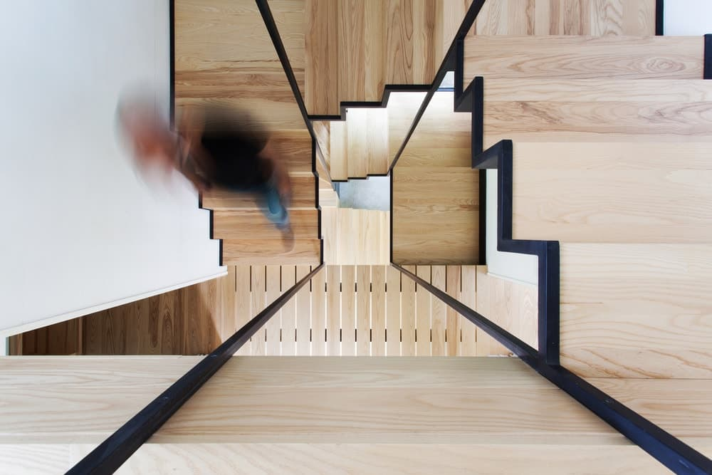 The spiral staircase features hardwood construction. Photo Credit: Francis Pelletier