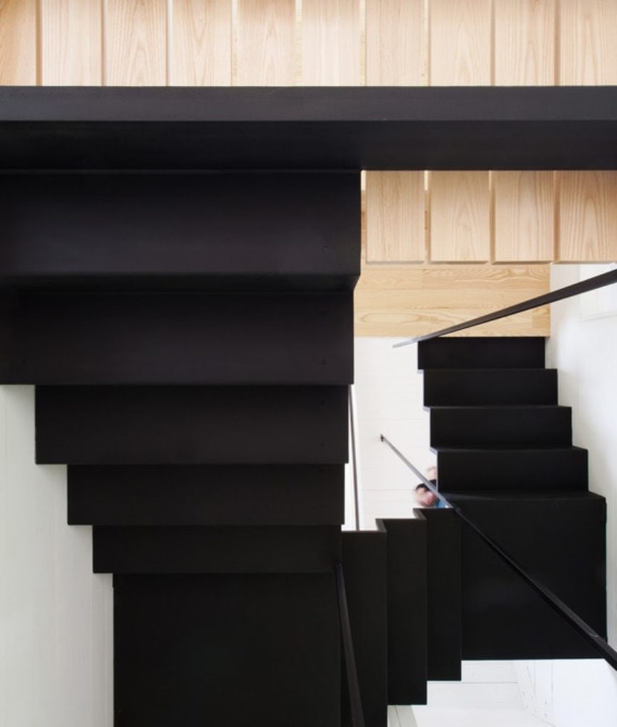 The house boasts a stylish contemporary spiral staircase. Photo Credit: Francis Pelletier