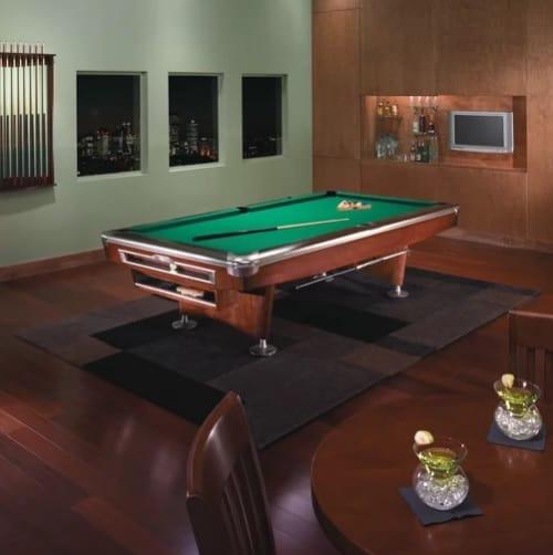 Large, mahogany pool table.