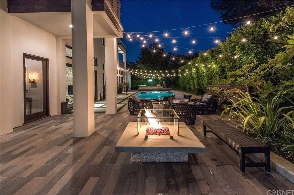 A patio with a fire pit creates awesome outdoor experience during night time.