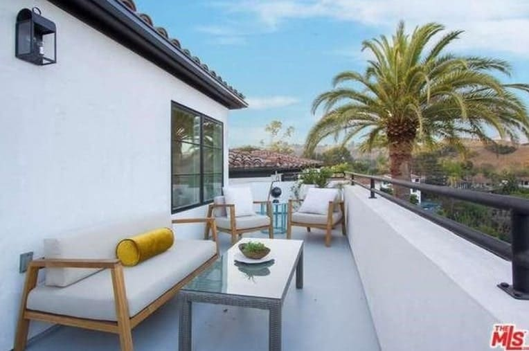 A balcony type patio can be the perfect spot for guests to have a look at the beautiful Hollywood Hills.