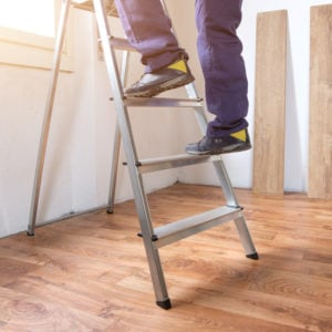 Man ascending step ladder