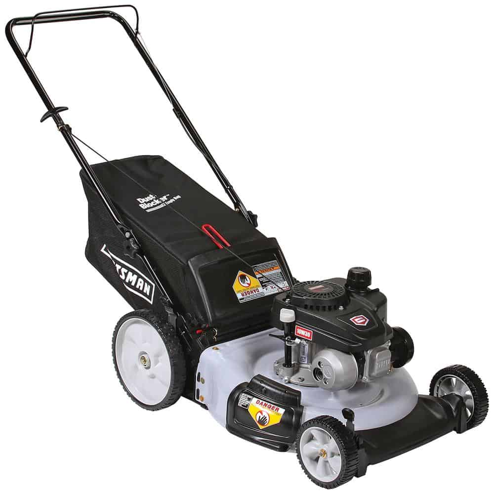 Manual powered lawn mower with high rear wheels and a pull starting system.