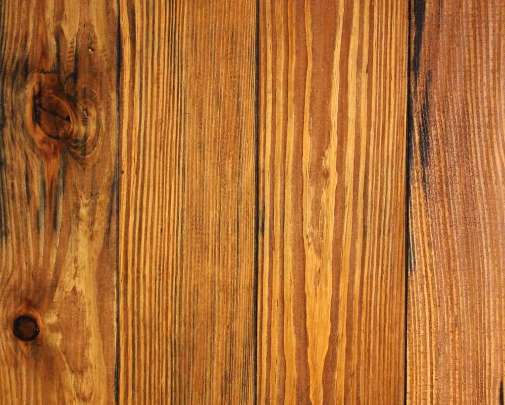 Pine flooring with a medium, honey dew tone.