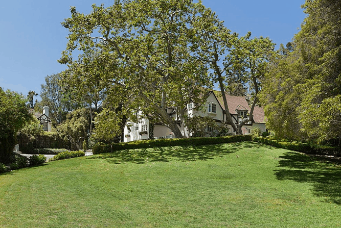 The property's backyard is so huge featuring healthy and well-maintained lawn and trees.