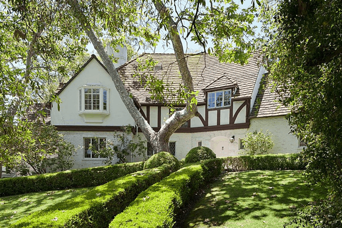 The front view of the house boasts the healthy green garden of the Disney CEO.