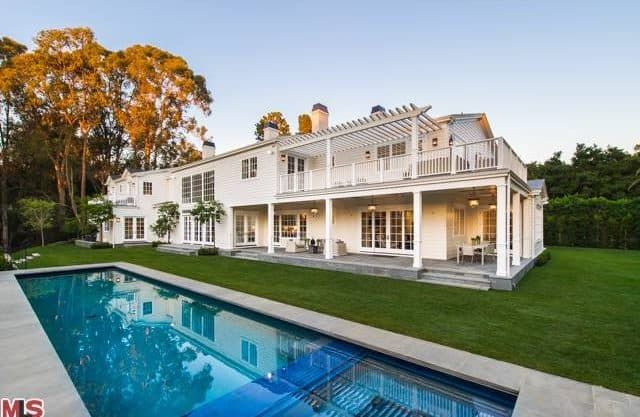 The outside view focuses on the well-placed patio and rectangular pool.