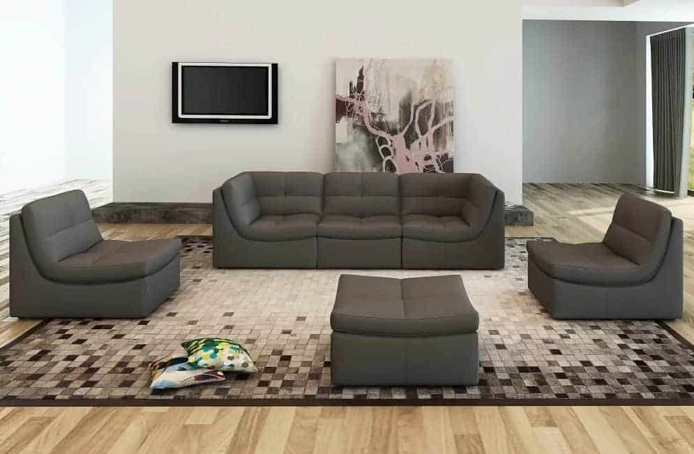 Monaco leather sectional sofa with ottoman and espresso finish.