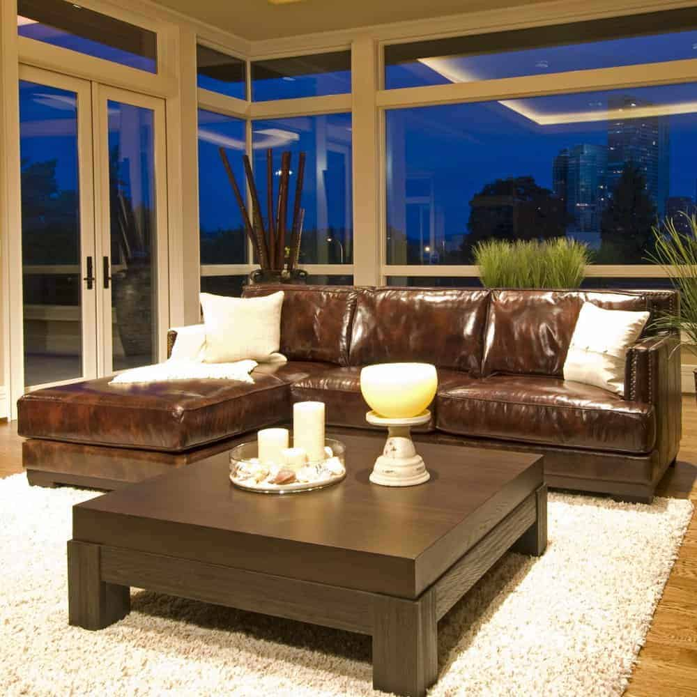 Top grain leather sectional sofa with high-density foam padding and elegant saddle color.