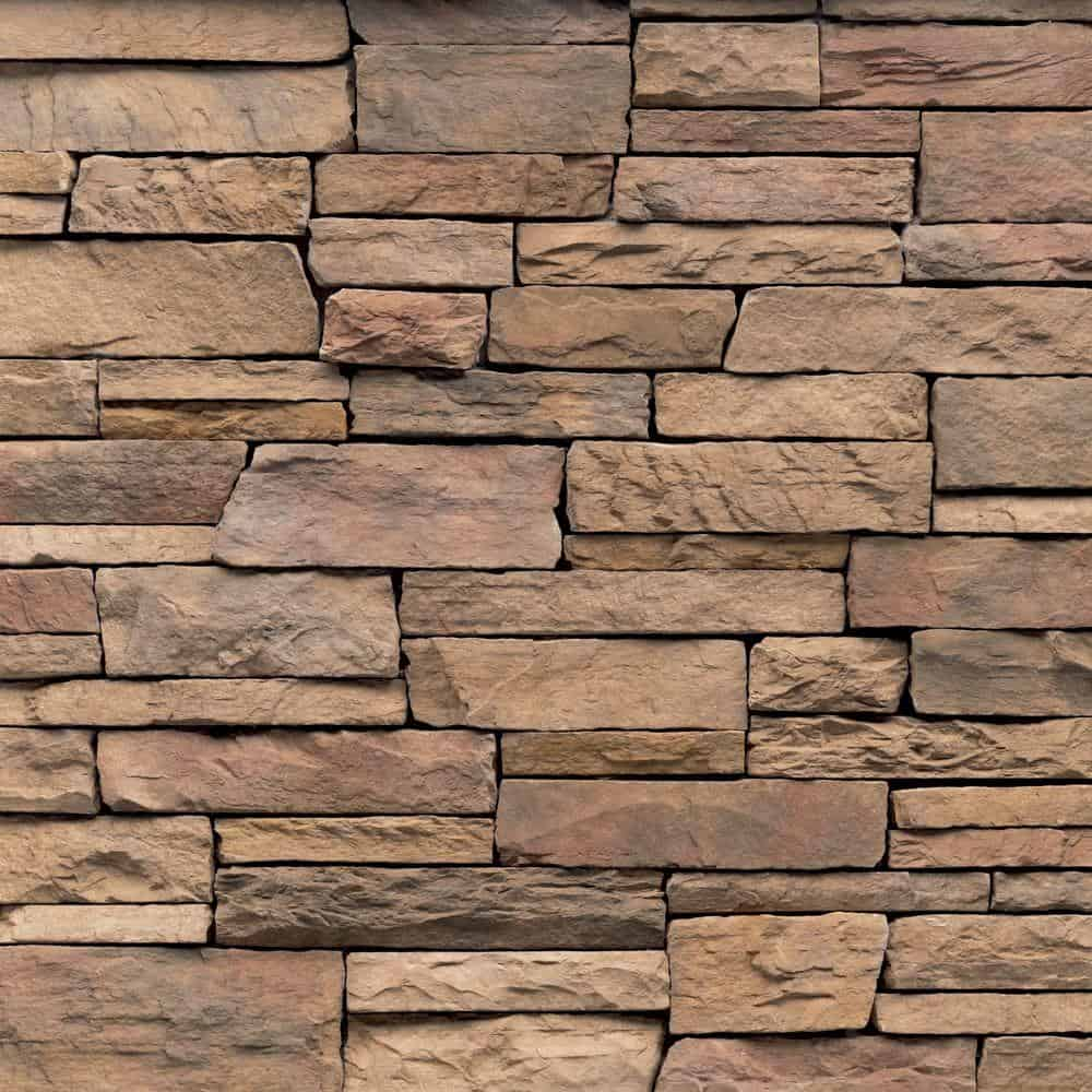 Natural brown stone siding with different lengths for random patterns,