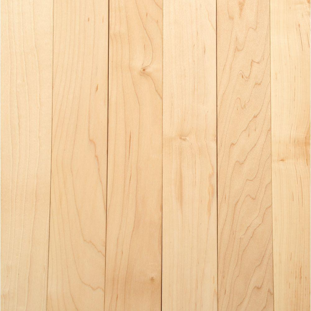 Natural maple, glossy hardwood flooring in a traditional style.