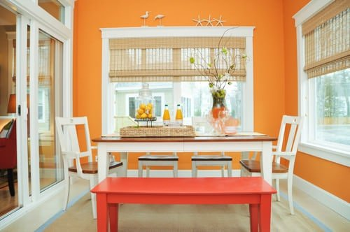 Dining Room With Orange Accent Wall