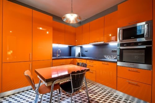 Orange kitchen with a touch of blue, black and white.