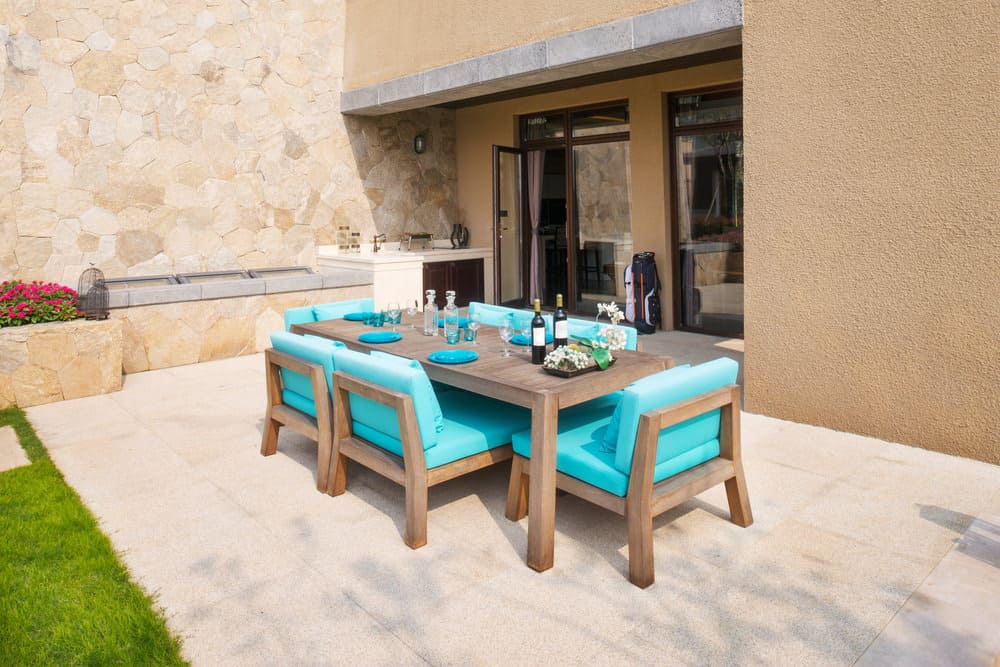 Patio with dining table and chairs