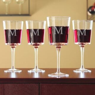 Personalized wine glass with a printed initial in front.