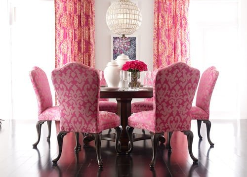 Dining room with pink accents.