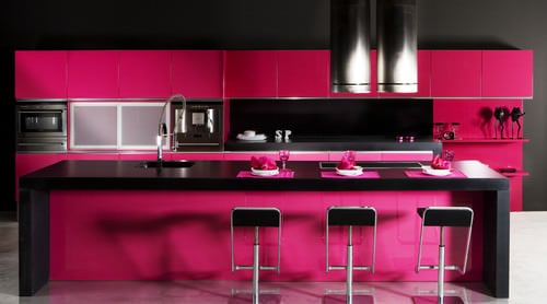 Pink and black kitchen.