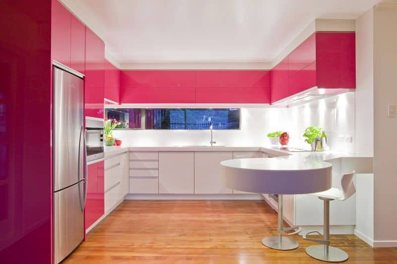 Pink and white kitchen.