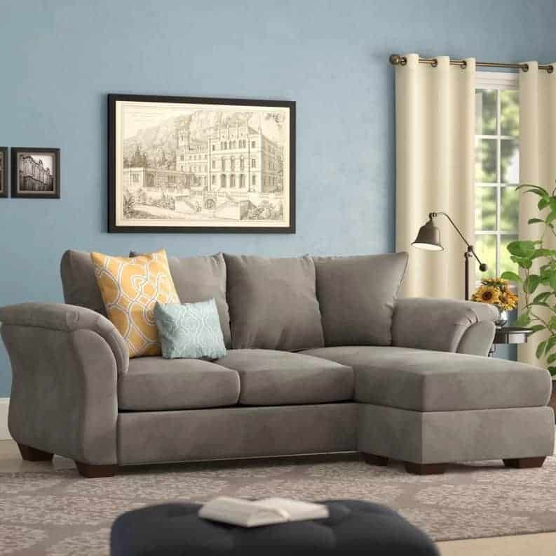 Espresso sectional sofa pillow arms and back and removable seat cushion.