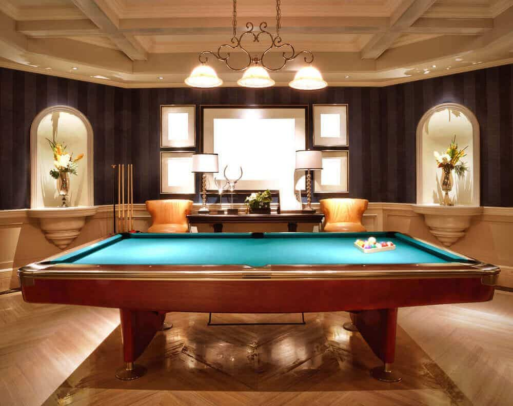 Full Size Wood Billiards Table In Elegant Games Room With Coffered Ceiling  And Light Hardwood Flooring