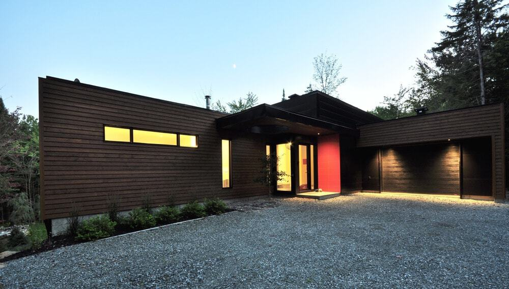 The house also includes a spacious garage. Photo Credit: Stéphane Lemire
