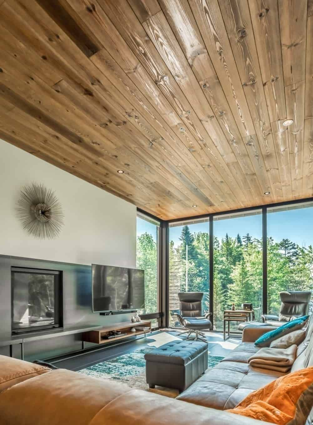 Another look at the living room showcasing the perfect blend of the sofa set and hardwood ceiling. Photo Credit: Dominic Boudreau