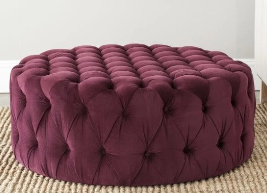 A tufted circular ottoman in wild and funky color.