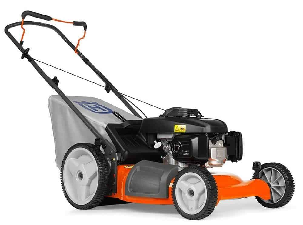 Gas powered 3-in-1 push lawn mower with high rear wheelsand adjustable handle.