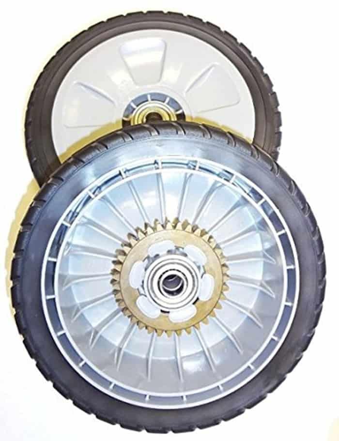 Rear wheel drive lawn mower is pushed forward by its back wheels.