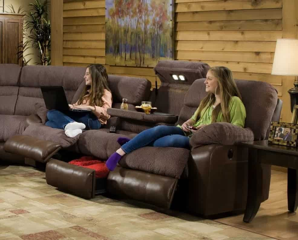 Reversible reclining sectional sofa with sinuous spring seat construction and faux leather upholstery.