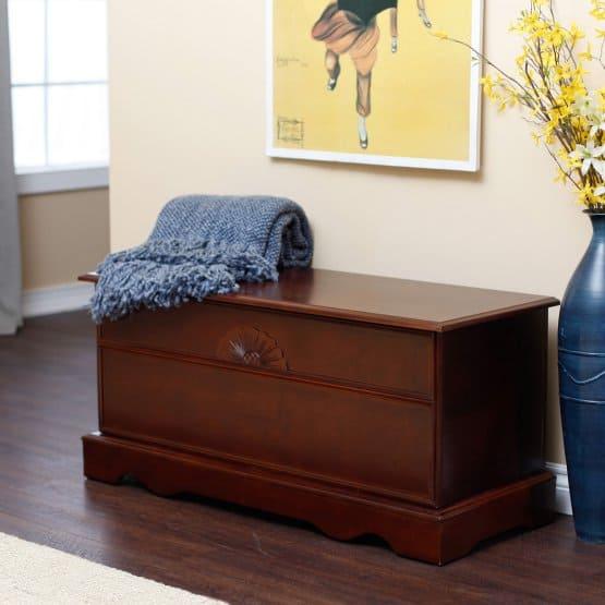 Cedar chest with a cherry finish.