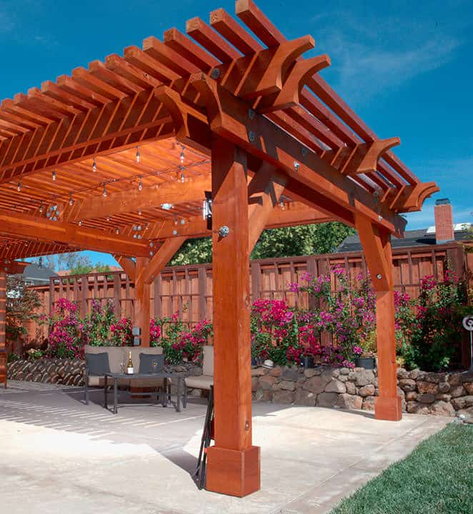 Backyard pergola built with redwood on patio