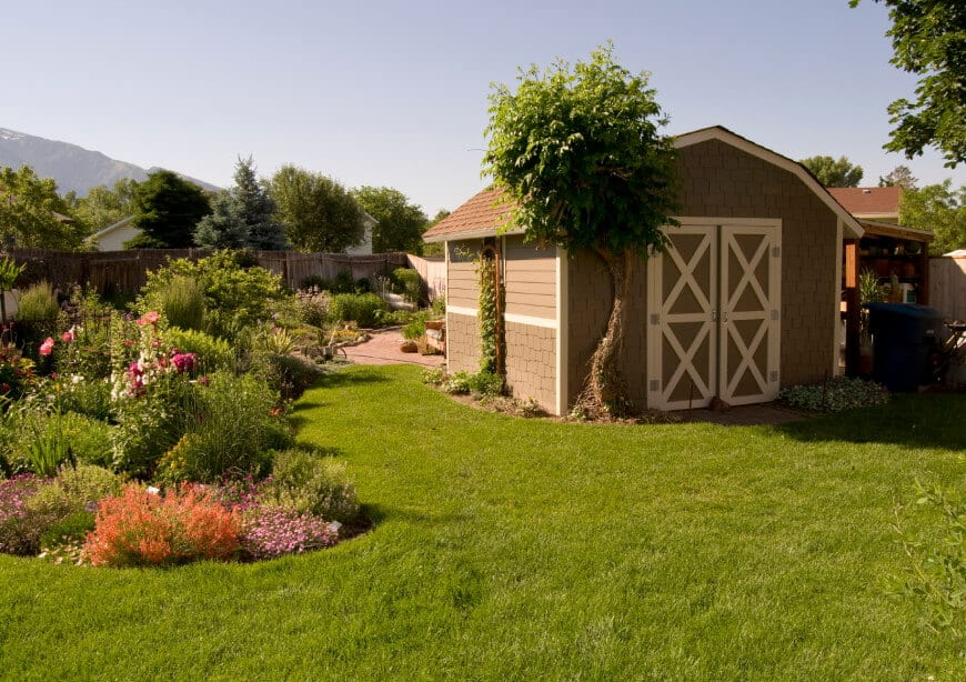 A beautiful backyard with a well-maintained lawn.