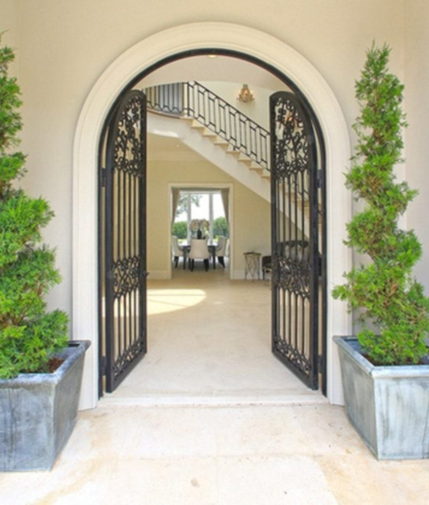 The entry features a traditional elegant foyer.