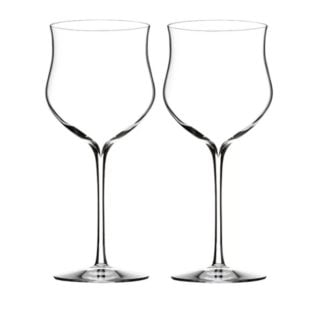 Rose crystal wine glasses with slim stems.