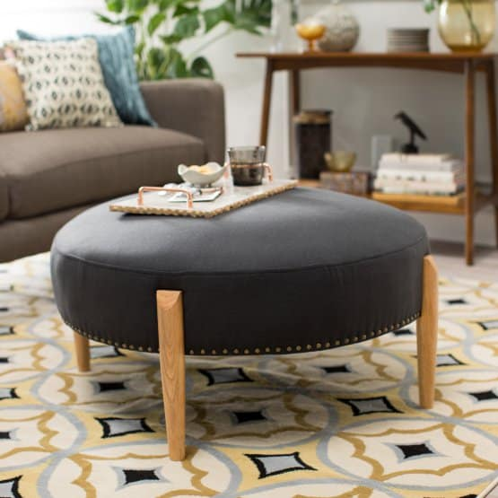 A round sturdy-looking ottoman.