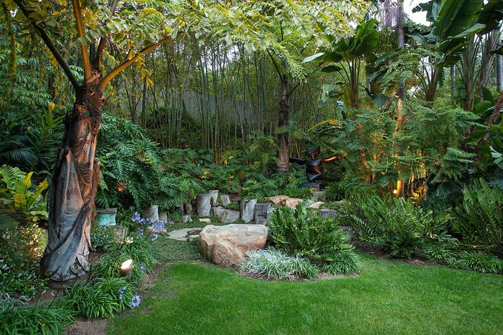 The garden boast healthy plants, lawn and trees.