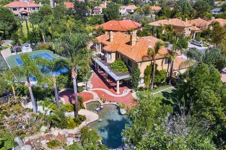 The aerial view of the mansion shows the beauty of the tropical landscape surrounding the house.